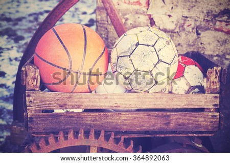 Vintage old film stylized used balls in a basket, shallow depth of field. - stock photo