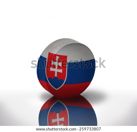 vintage old hockey puck with the slovak flag - stock photo