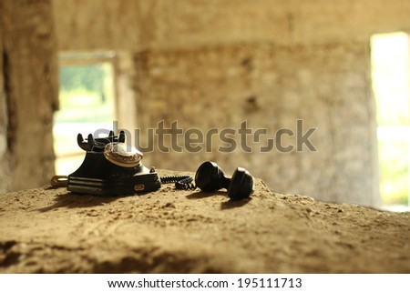 Vintage old phone in ruins. - stock photo