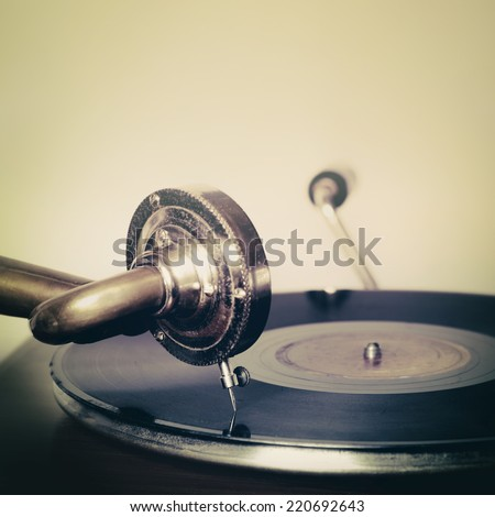 Vintage old record player gramophone needle on record - stock photo