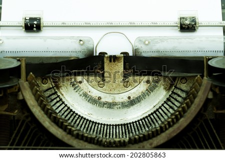 vintage old typewriter with paper - stock photo