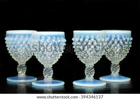 Vintage opalescent blue hobnail liqueur glasses - stock photo