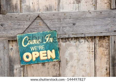 Vintage open sign on old wooden door - stock photo