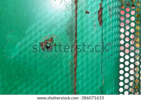 Vintage or green grungy steel texture background with old rusty screws with peeling paint - stock photo