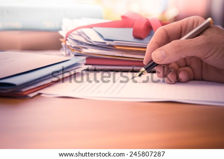 Vintage or retro style Hand with pen writing a letter by mail  - stock photo