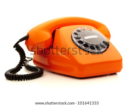 Vintage orange telephone over white background - stock photo