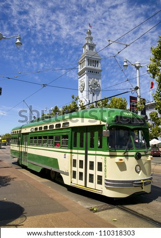 Vintage Overhead Cable Retro San Francisco Trolley Car moves through the street - stock photo