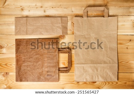Vintage paper bag collection on natural wooden texture - stock photo