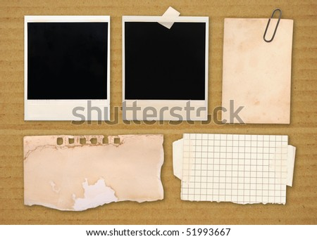 vintage paper notes isolated over brown cardboard background - stock photo
