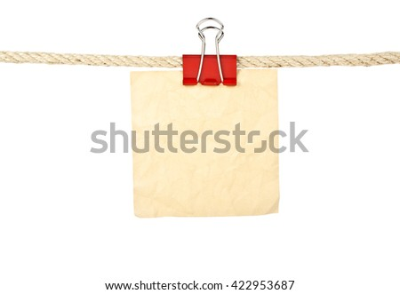 Vintage paper on a rope isolated on white background, closeup - stock photo