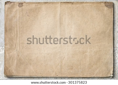 vintage paper on old gray texture - stock photo