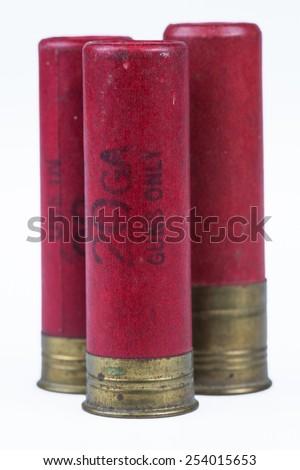 Vintage paper wrapped 20 gauge red shotgun shells - stock photo