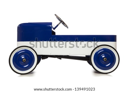 Vintage pedal car toy isolated on white background - stock photo