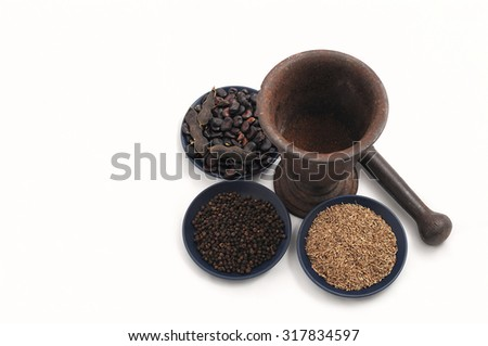 vintage pestle with flax seeds,black pepper and beans on blue plate - stock photo