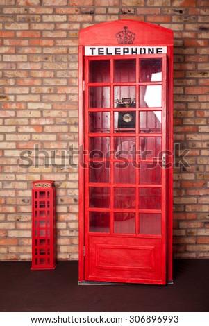 vintage phone booth near brick wall. Telephone box. Retro call box - stock photo