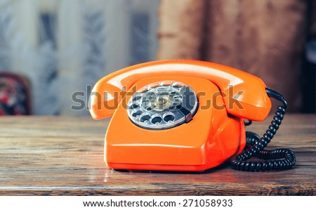 Vintage phone on the table - stock photo