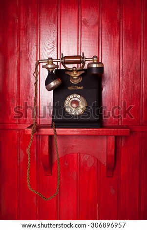 vintage phone on wooden red background. Telephone box. Retro call box - stock photo