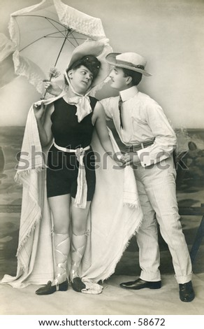 Vintage photo, circa 1900 of a man and woman with a beach umbrella - stock photo