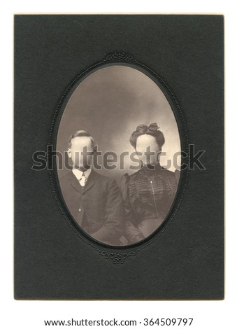 Vintage photo family in the late 19 th century on background. Faces cloned out. You can use the frame or add your face. - stock photo