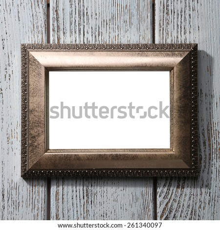 Vintage photo frame on color wooden background - stock photo