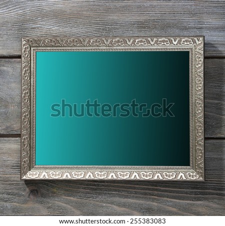 Vintage photo frame on wooden background - stock photo