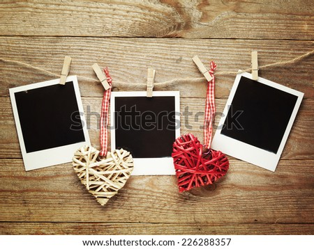 Vintage photo frames decorated for holiday on the wooden board background with space for your text  - stock photo