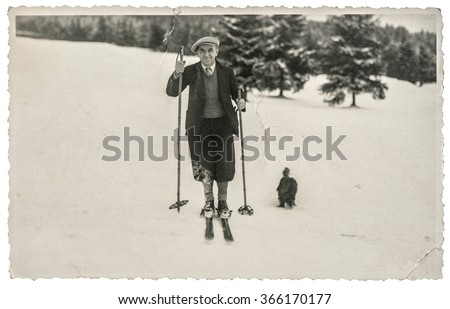 Vintage photo from skiing man in snow. Antique picture with original film grain and scratches - stock photo