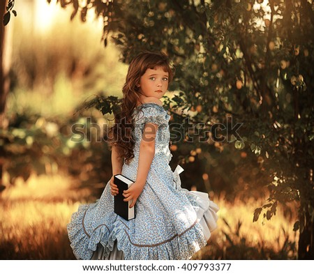 Vintage photo of a beautiful girl with a book - stock photo