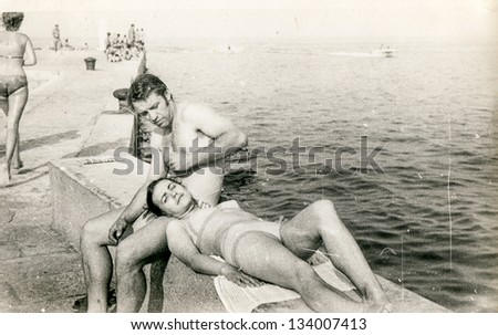 Vintage photo of a couple at the seaside (seventies) - stock photo