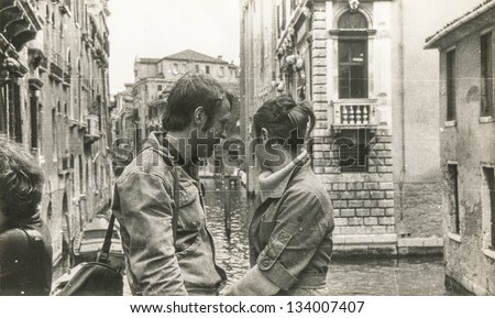 Vintage photo of a couple in honey moon trip to Venice (seventies) - stock photo