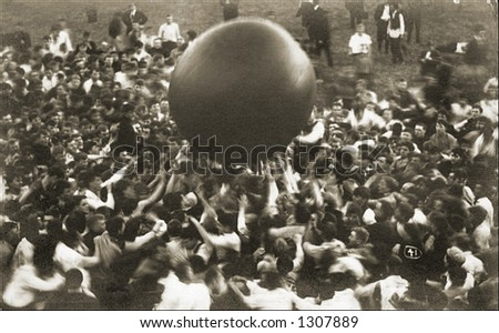Vintage photo of a Crowd Tossing Large Ball Around - stock photo