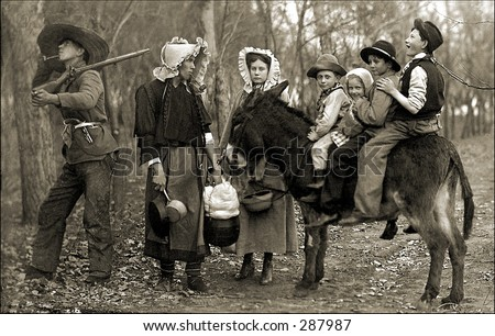 Vintage photo of a Family of Hillbillies With Kids Riding Donkey In Woods - stock photo