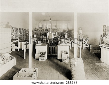 Vintage photo of a Grocer In His General Store - stock photo