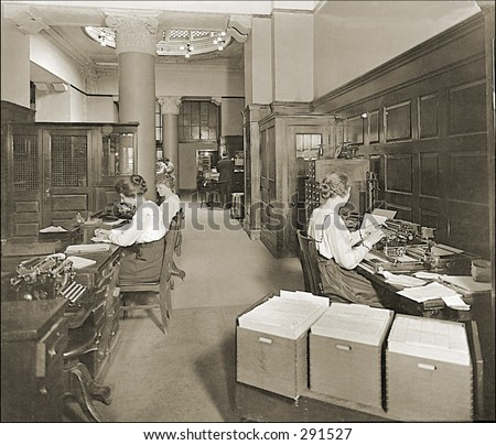 Vintage photo of a Secretaries Working in Office Typing Pool - stock photo