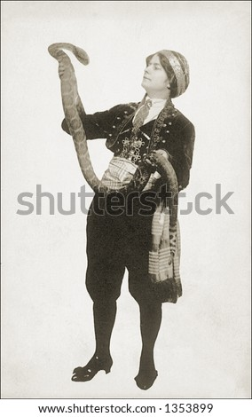 Vintage photo of a Woman Holding Up a Large Snake - stock photo