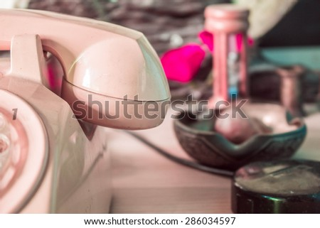 Vintage photo of an old phone. - stock photo