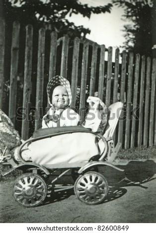 Vintage photo of baby girl (1955) - stock photo