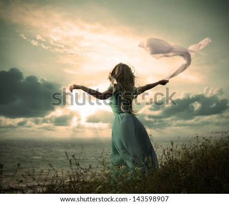 Vintage Photo of Blonde Woman with Scarf at the Sea - stock photo