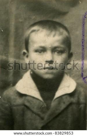 Vintage photo of boy (twenties) - stock photo