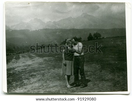 Vintage photo of couple outdoor (fifties) - stock photo