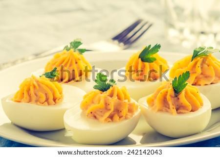vintage photo of deviled eggs - stock photo