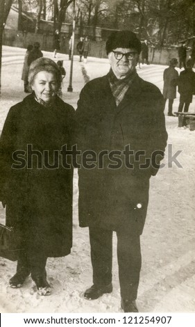 Vintage photo of elderly couple walking (sixties) - stock photo
