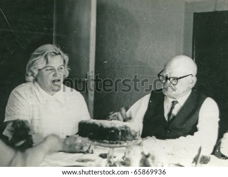 Vintage photo of elderly father and adult daughter (sixties) - stock photo