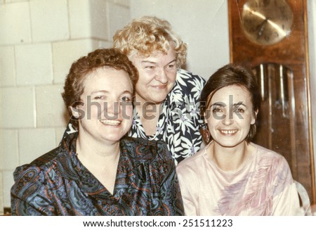 Vintage photo of elderly woman with her daughters in law, eighties - stock photo