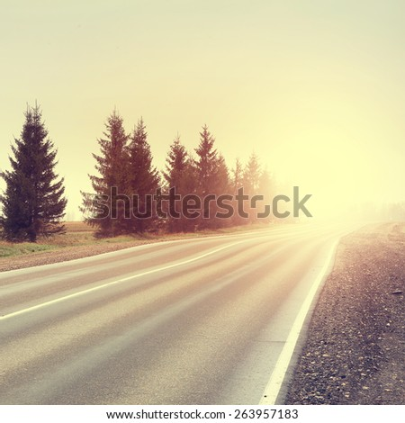 Vintage photo of empty rural road. - stock photo