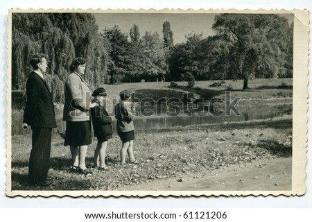 Vintage photo of family (early fifties) - stock photo