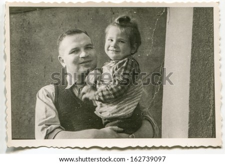 Vintage photo of father with daughter, fifties - stock photo