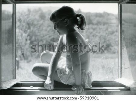 Vintage photo of girl (circa 1960) - stock photo