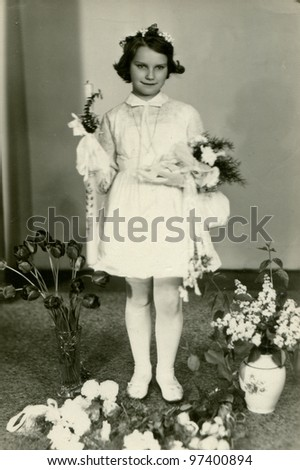 Vintage photo of girl - first communion, early sixties - stock photo