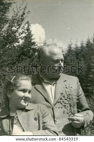Vintage photo of grandfather and granddaughter (fifties) - stock photo